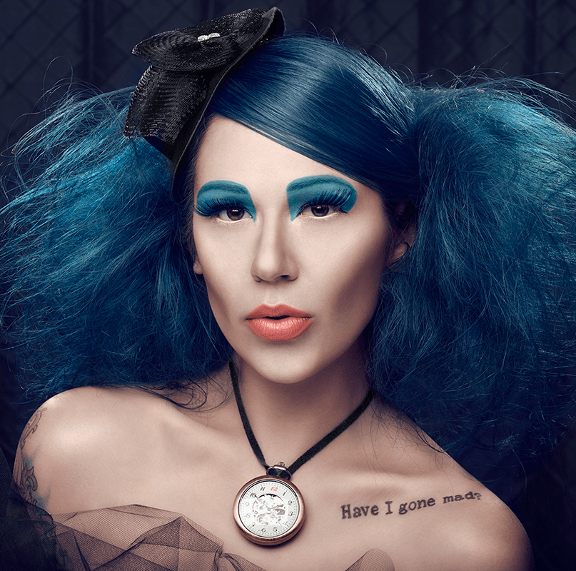 close up of woman with blue hair with makeup done